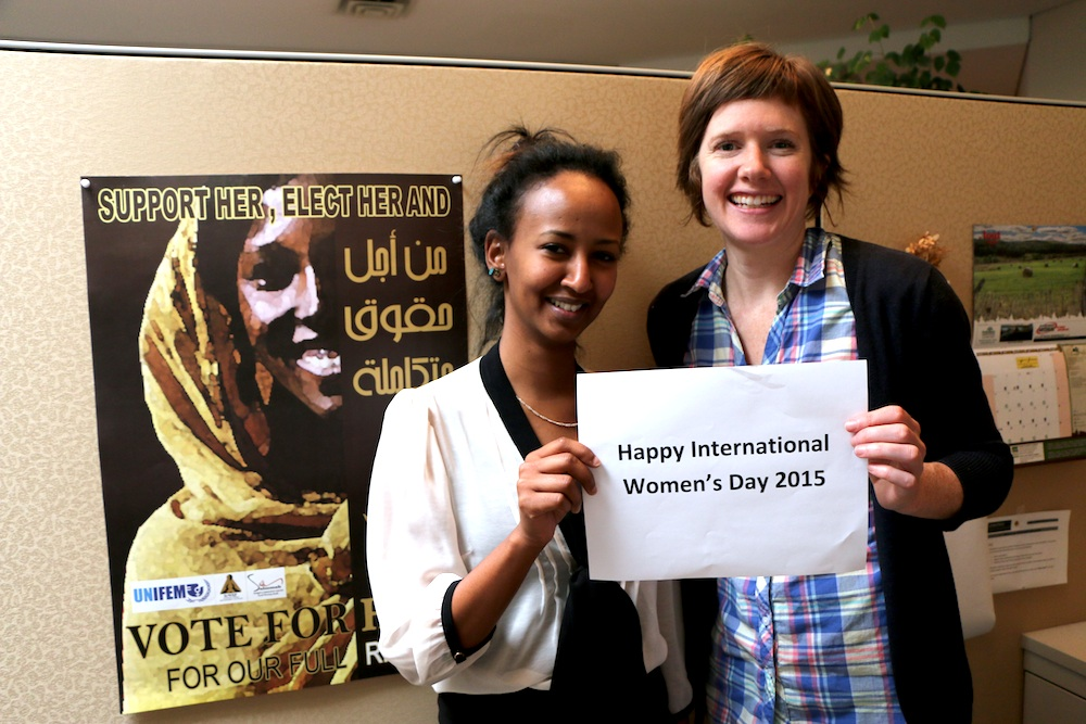 Maha Babeker and Kathryn Dingle with an IWD sign