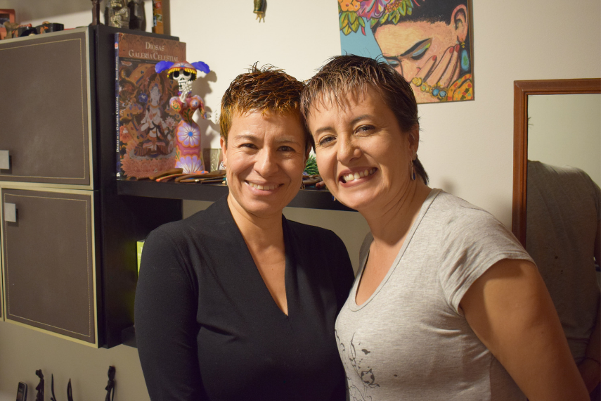 Two women, Adriana and Marcela, smiling together