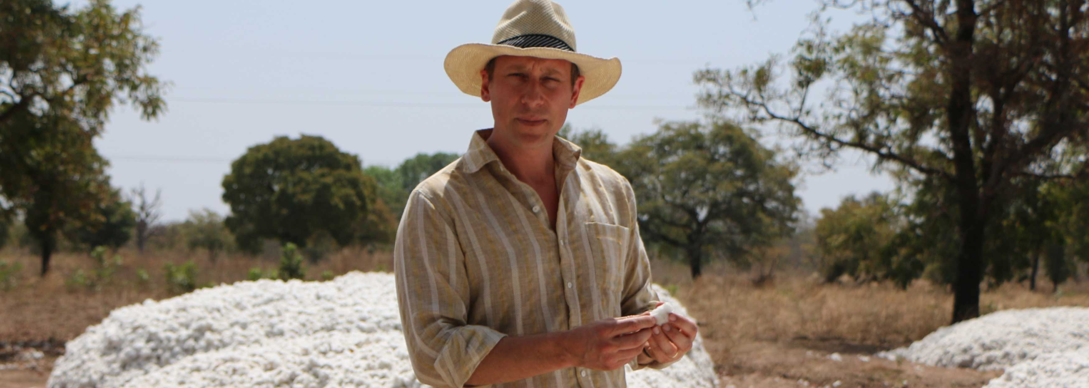 Staff member Eric Chaurette examines a pile of Bt cotton in Burkina Faso