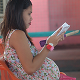Pregnant woman waiting for care in the Philippines