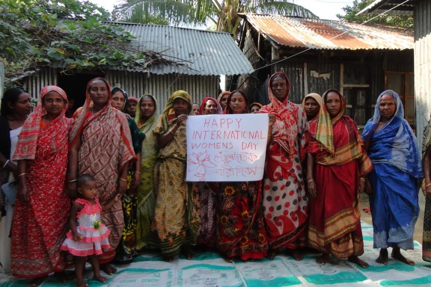 Group of women holding a sign wishing a happy International Women's Day