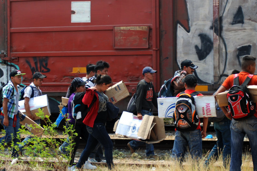 Central American migrants about to board la Bestia (the Beast), the infamous train that will carry them across Mexico.